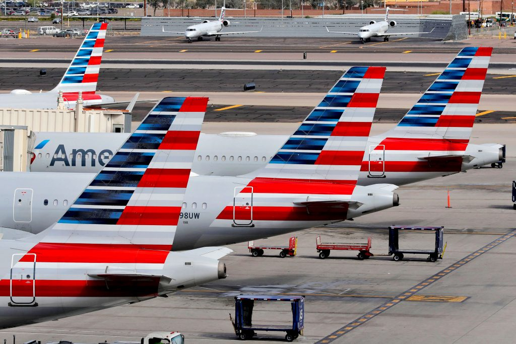 American Airlines plans to apply for aid, offers partial pay
